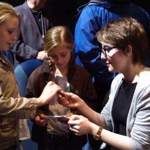 Filmmaker Slater Jewell-Kemker signs autographs.