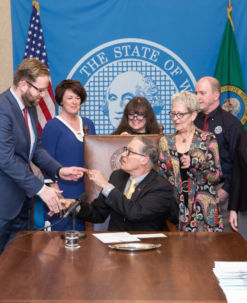 Governor Jay Inslee signs Substitute Senate Bill No. 6273, March 29, 2016, Relating to safe technology use and digital citizenship in public schools. Pictured: Inslee hands signing pen to Sen. Marko Liias. From Left: Liias, Carolyn Logue, representing the Washington Library Media Association, and Lynn Ziegler, Claire Beach and Michael Danielson of Action for Media Education