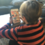 child with video game on tablet