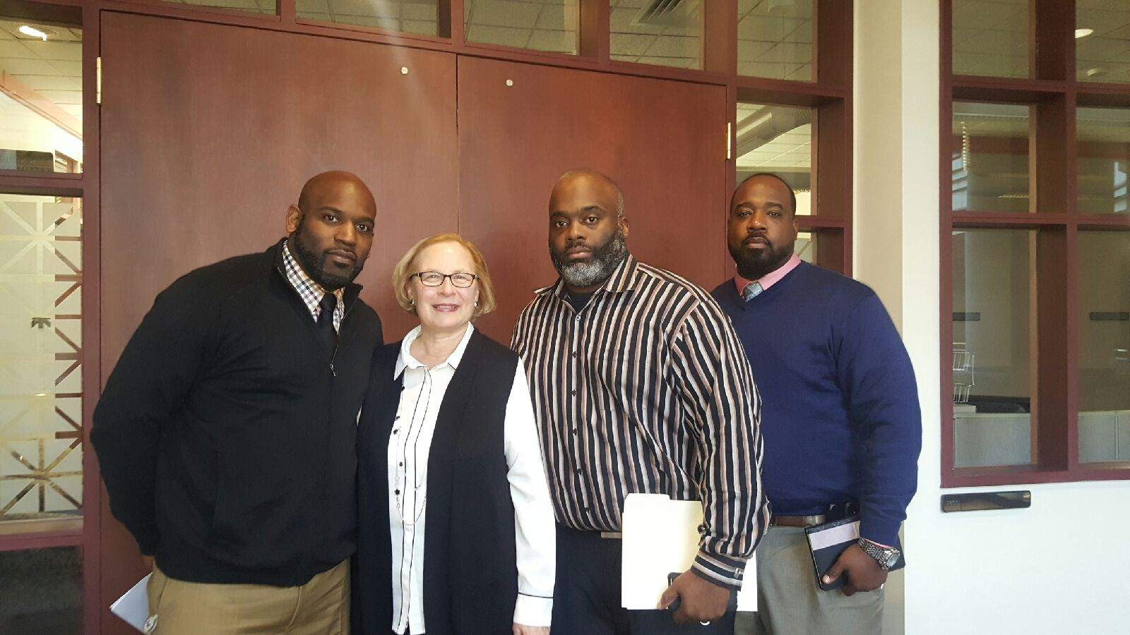 Members of Welcome to Reality meet with the sponsoring senator (from left to right): Anthony Gay, Sen. Terry Gerratana, Qur-an Webb, Marcus Stallworth